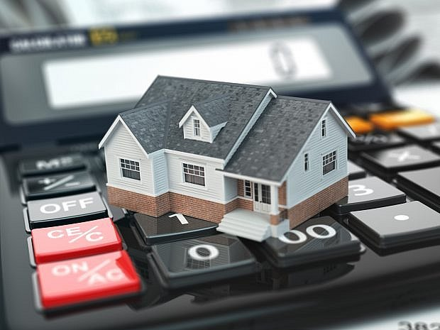 Mortgage calculator. House on buttons. Real estate concept. - Stock image 508545940