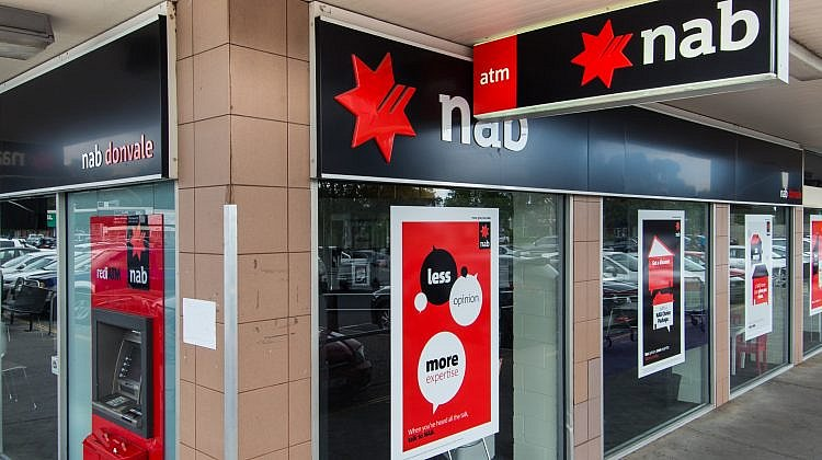 Dropping like flies: NAB joins growing list of banks cutting savings rates