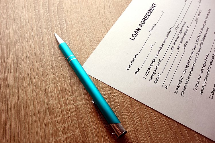 Loan agreement and pen on desk
